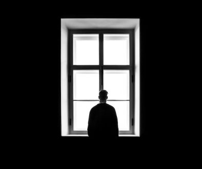 Man standing near the window